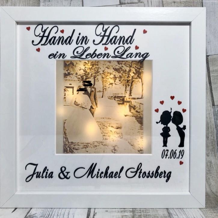 "Rahmen beleuchtet ""Hand in Hand"""